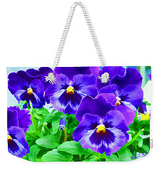 Weekender Tote Bag featuring the photograph Purple Pansies by Wendy McKennon
