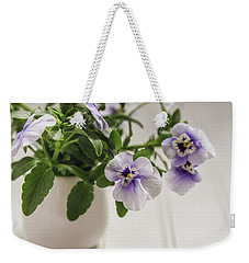 Weekender Tote Bag featuring the photograph Purple Pansy Flowers by Kim Hojnacki