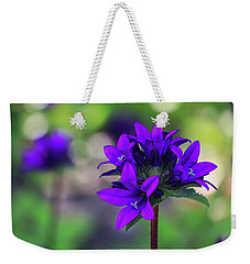 Weekender Tote Bag featuring the photograph Purple Spring Flower by Cristina Stefan