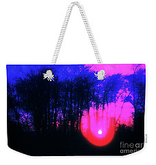 Weekender Tote Bag featuring the photograph Purple Sunset by Craig J Satterlee