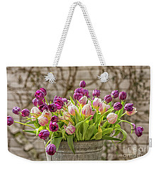 Weekender Tote Bag featuring the photograph Purple Tulips In A Bucket by Patricia Hofmeester
