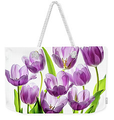 Weekender Tote Bag featuring the photograph Purple Tulips by Rebecca Cozart