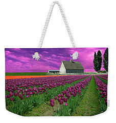 Weekender Tote Bag featuring the photograph Purple Tulips With Pink Sky by Jeff Burgess