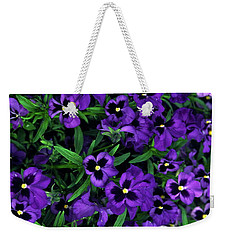 Weekender Tote Bag featuring the photograph Purple Viola Flowers by Sally Weigand