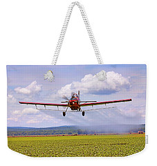 Weekender Tote Bag featuring the photograph Putting It Down - Ag Pilot - Crop Duster by Jason Politte