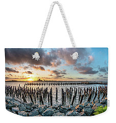 Weekender Tote Bag featuring the photograph Pylons Mill Sunset by Greg Nyquist