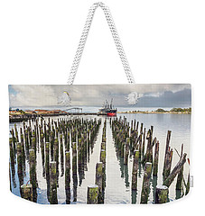 Weekender Tote Bag featuring the photograph Pylons To The Ship by Greg Nyquist