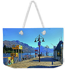 Weekender Tote Bag featuring the digital art Queenstown's Majestic Mountains by Kathy Kelly
