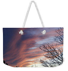 Weekender Tote Bag featuring the photograph Raging Sky by Barbara Griffin