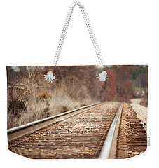 Weekender Tote Bag featuring the photograph Rails by Todd Blanchard