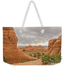 Weekender Tote Bag featuring the photograph Rain In The Distance At Arches by Sue Smith