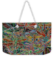 Weekender Tote Bag featuring the mixed media Rainbow Dragonflies by Carol Cavalaris