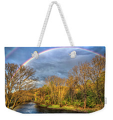 Weekender Tote Bag featuring the photograph Rainbow Over The River by Debra and Dave Vanderlaan
