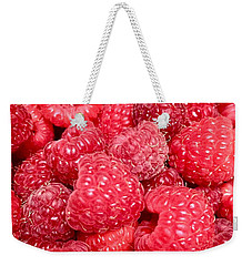 Weekender Tote Bag featuring the photograph Raspberries by Cristina Stefan