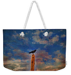 Weekender Tote Bag featuring the photograph Raven Pole by Jan Amiss Photography