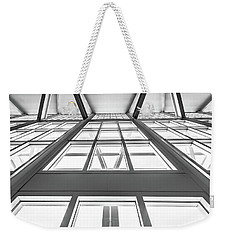 Reaching Weekender Tote Bag by Wade Brooks
