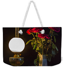 Weekender Tote Bag featuring the photograph Reading By Oil Lamp by Brian Roscorla