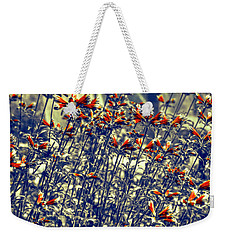 Weekender Tote Bag featuring the photograph Red Army by Wayne Sherriff