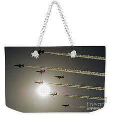 Weekender Tote Bag featuring the photograph Red Arrows Backlit Arrival  by Gary Eason