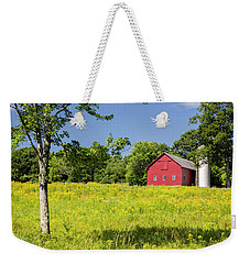 Weekender Tote Bag featuring the photograph Red Barn In Yellow Goldenrod Field by Betty Denise