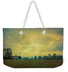 Red Barn Under Stormy Skies Weekender Tote Bag by Don Schwartz