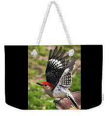 Weekender Tote Bag featuring the photograph Red Bellied Woodpecker Take Off by Terry DeLuco