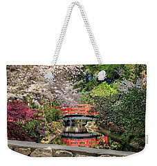 Weekender Tote Bag featuring the photograph Red Bridge Spring Reflection by James Eddy