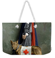 Weekender Tote Bag featuring the photograph Red Cross Nurse by Granger