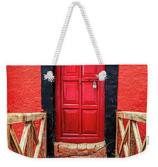 Weekender Tote Bag featuring the photograph Red Door At A Monastery by Alexey Stiop