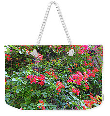 Weekender Tote Bag featuring the photograph Red Flower Hedge by Francesca Mackenney