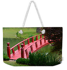 Weekender Tote Bag featuring the photograph Red Garden Bridge by Kathleen Stephens