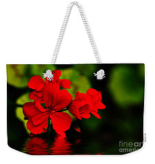 Red Geranium On Water Weekender Tote Bag by Kaye Menner
