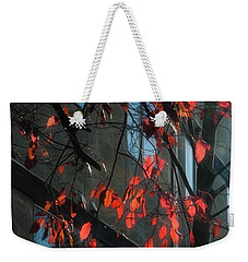 Weekender Tote Bag featuring the photograph Red Leaves by Yulia Kazansky