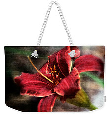 Weekender Tote Bag featuring the photograph Red Lilly by Michaela Preston