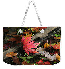 Weekender Tote Bag featuring the photograph Red Maple Leaf In Pond by Doris Potter