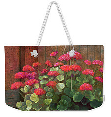 Weekender Tote Bag featuring the painting Red Petals Geraniums by Nancy Lee Moran