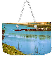 Weekender Tote Bag featuring the photograph Red River Crossing Old Bridge by Diana Mary Sharpton
