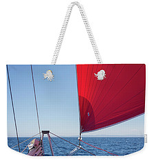 Weekender Tote Bag featuring the photograph Red Sail On A Catamaran by Clare Bambers