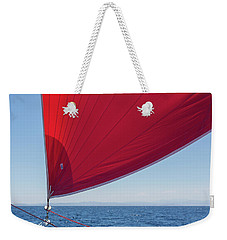 Weekender Tote Bag featuring the photograph Red Sail On A Catamaran 2 by Clare Bambers