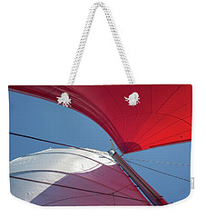 Weekender Tote Bag featuring the photograph Red Sail On A Catamaran 3 by Clare Bambers