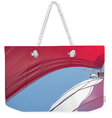 Weekender Tote Bag featuring the photograph Red Sail On A Catamaran 4 by Clare Bambers