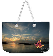 Weekender Tote Bag featuring the photograph Red Sails In The Sunset by Carol Lynn Coronios