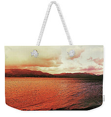 Weekender Tote Bag featuring the photograph Red Sky After Storms  by Chriss Pagani