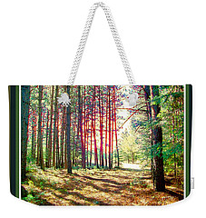 Weekender Tote Bag featuring the photograph Red Sun Through Trees by Shirley Moravec