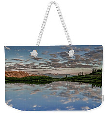Weekender Tote Bag featuring the photograph Reflection In A Mountain Pond by Don Schwartz