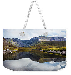 Weekender Tote Bag featuring the photograph Reflection Of The Macgillycuddy's Reeks In Lough Eagher by Semmick Photo