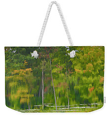 Weekender Tote Bag featuring the photograph Reflection On Muskrat Pond by Gary Hall