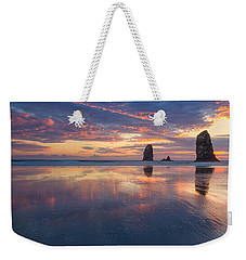 Weekender Tote Bag featuring the photograph Reflections At Cannon Beach by Patricia Davidson
