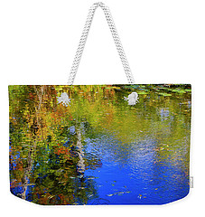 Weekender Tote Bag featuring the photograph Reflections In A Pond by Gary Hall