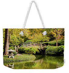 Weekender Tote Bag featuring the photograph Reflections In The Japanese Garden by Iris Greenwell